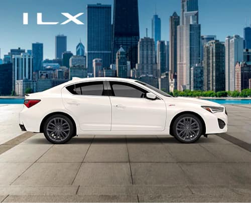 Side view of white Acura ILX in front of city
