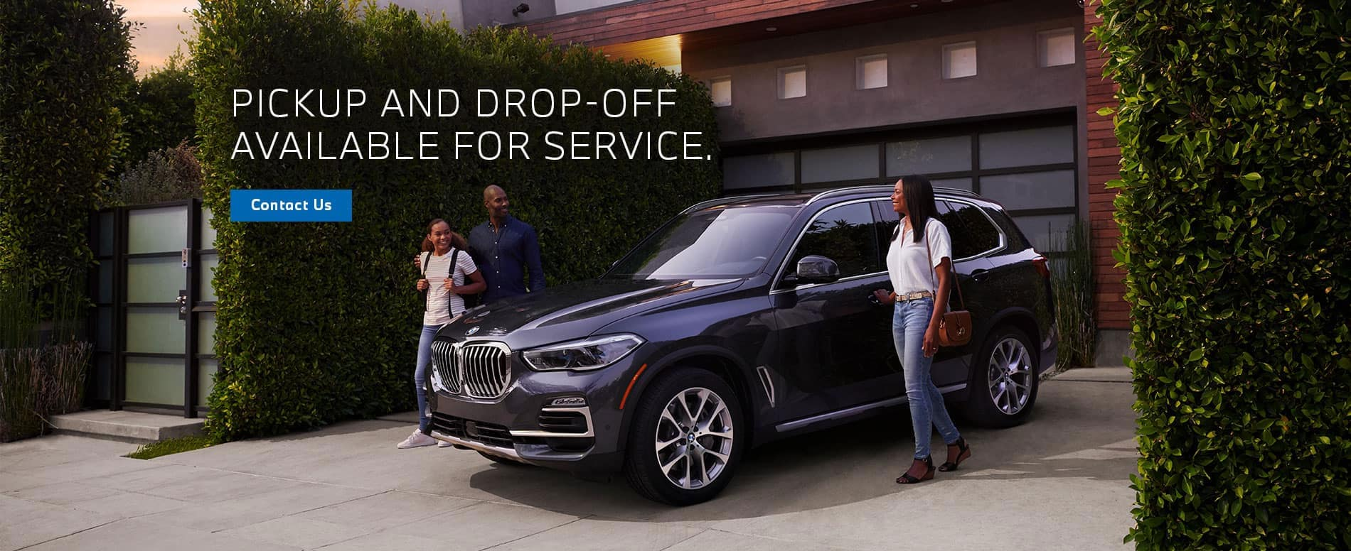 Pick up and drop off available for service. Black car parked in a driveway with family.