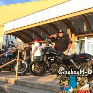 Cowboy Harley Davidson Party With Us Pic Two Bikes on stairs with people around