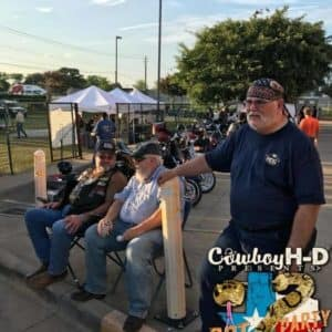 Cowboy Harley Davidson Party With Us Pic Men sitting and talking with bikes behind them