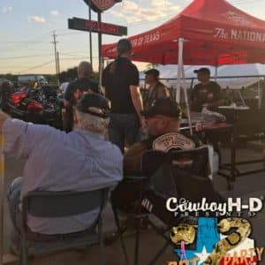 Cowboy Harley Davidson Party With Us Pic People around Stand