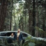 A man and young child in the woods with a 2020 Mazda CX-9 - El Dorado Mazda in McKinney, TX
