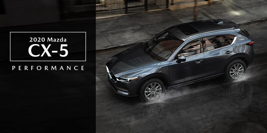 The 2020 Mazda CX-5 driving on a rainy street - El Dorado Mazda in McKinney, TX