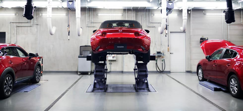 Red Mazda vehicles receiving service - El Dorado Mazda in McKinney, TX