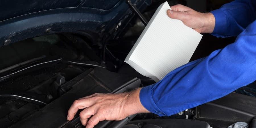 A man changing a car's air filter - El Dorado Mazda in McKinney, Texas