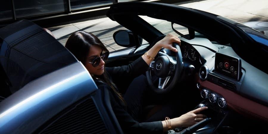 A woman inside a Mazda MX-5 Miata - El Dorado Mazda in McKinney, Texas