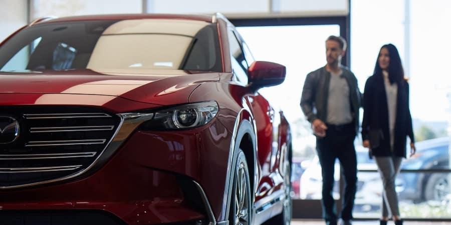 A man and woman in a Mazda dealership | El Dorado Mazda in McKinney, Texas