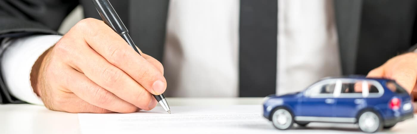 Man Signing Documents for Car