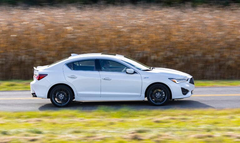 2020 Acura ILX exterior driving down country road