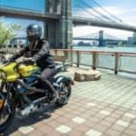 person riding harley davidson livewire on city deck