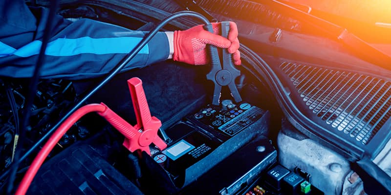 Mechanic setting up jumper cables