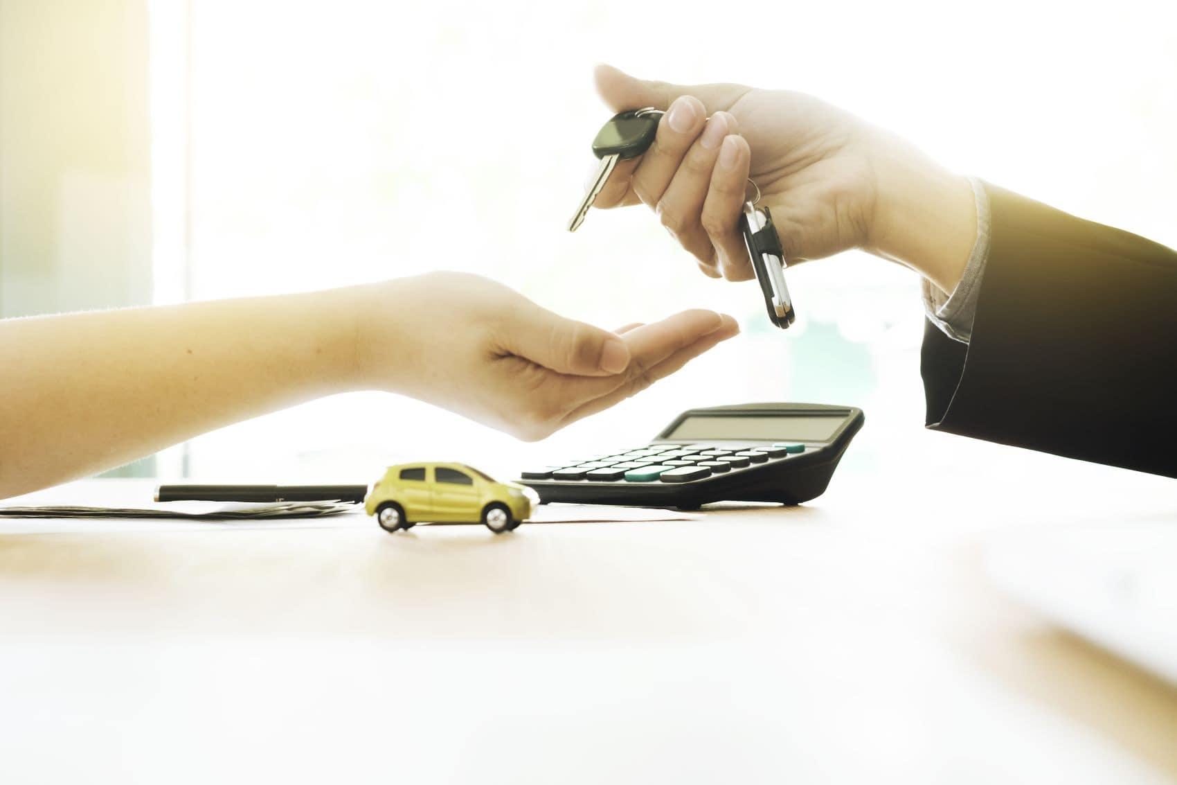 Handing over the keys after financing a Volkswagen Atlas Cross Sport
