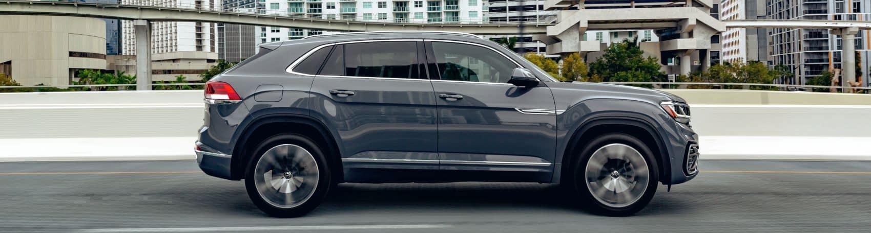 Platinum Gray Metallic Volkswagen Atlas Cross Sport on the highway