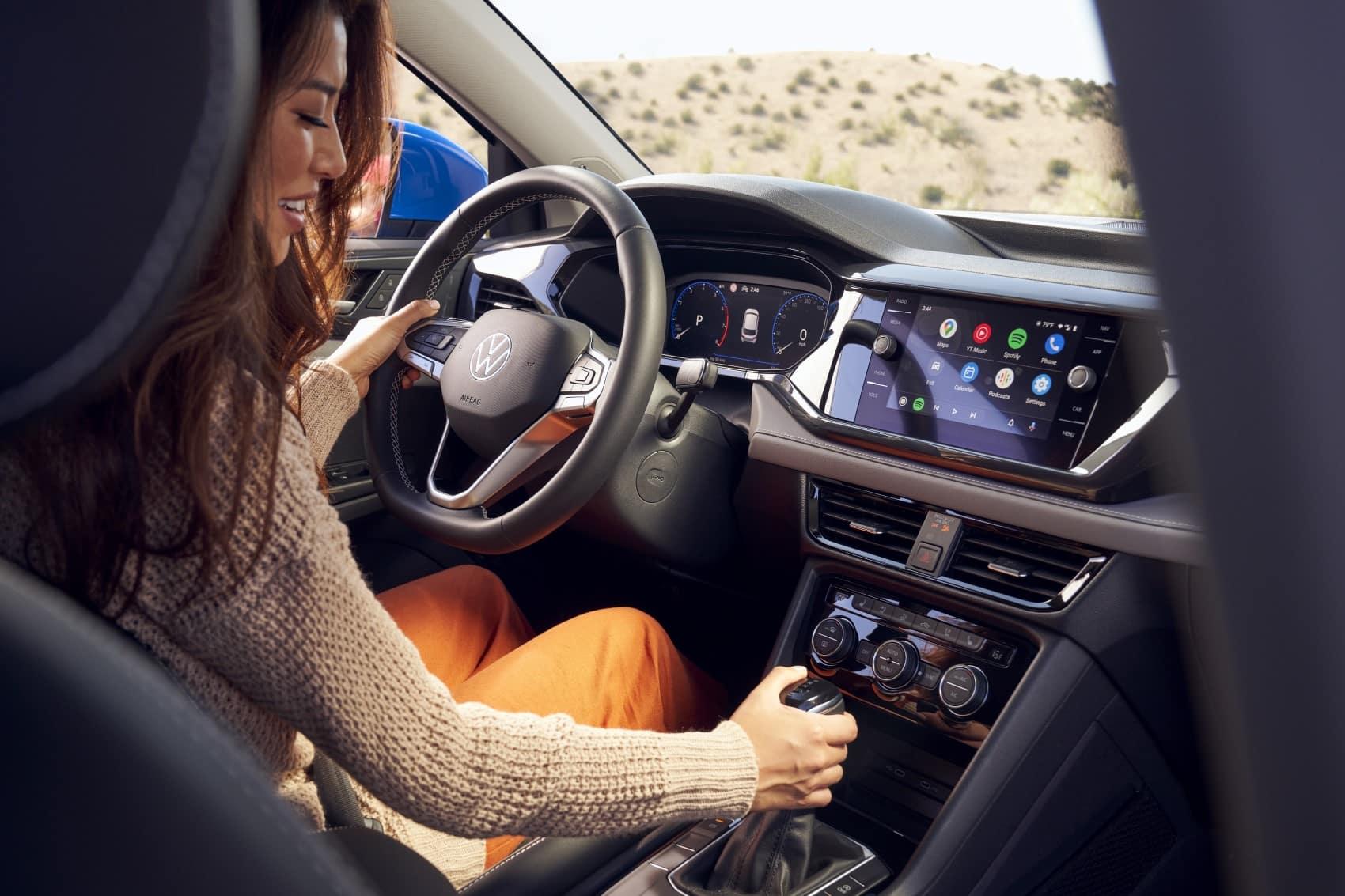2022 Volkswagen Taos interior shot women in driver's seat infotainment system