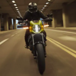 2020 harley davidson livewire yellow front view cruising down street