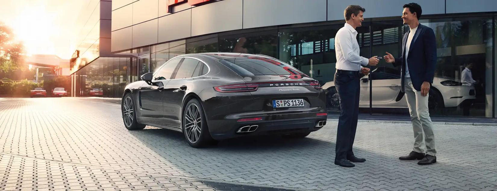 Man shaking Porsche salesman's hand