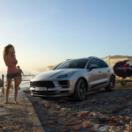 The 2021 Porsche Macan parked by the water towing a jet ski.