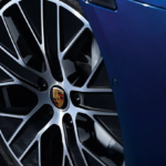 A blue 2021 Porsche Taycan and it's tires.