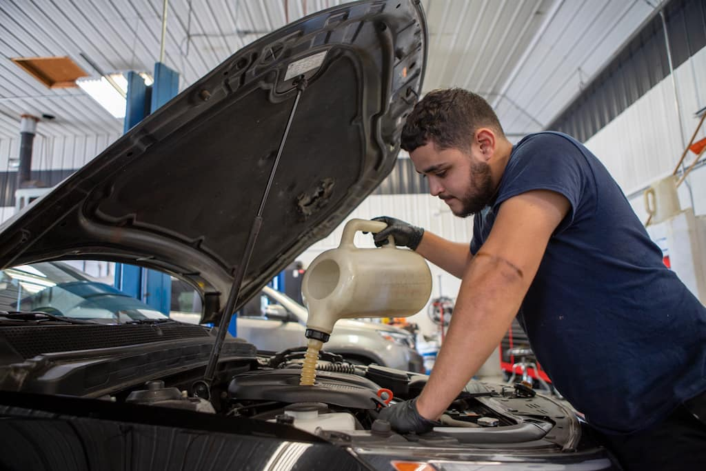 Rosen Kia Milwaukee technician working on car