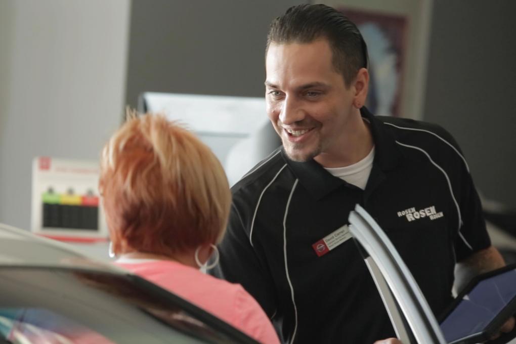 Rosen Nissan Madison service center advisor shaking hands with customer