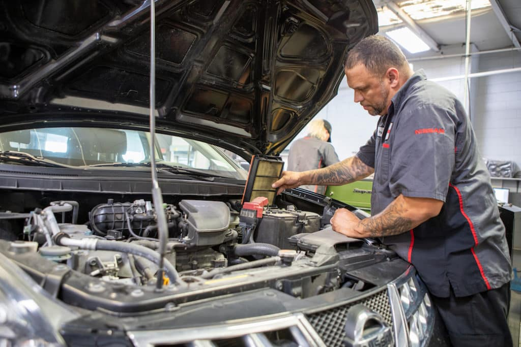 Nissan service technician providing expert care