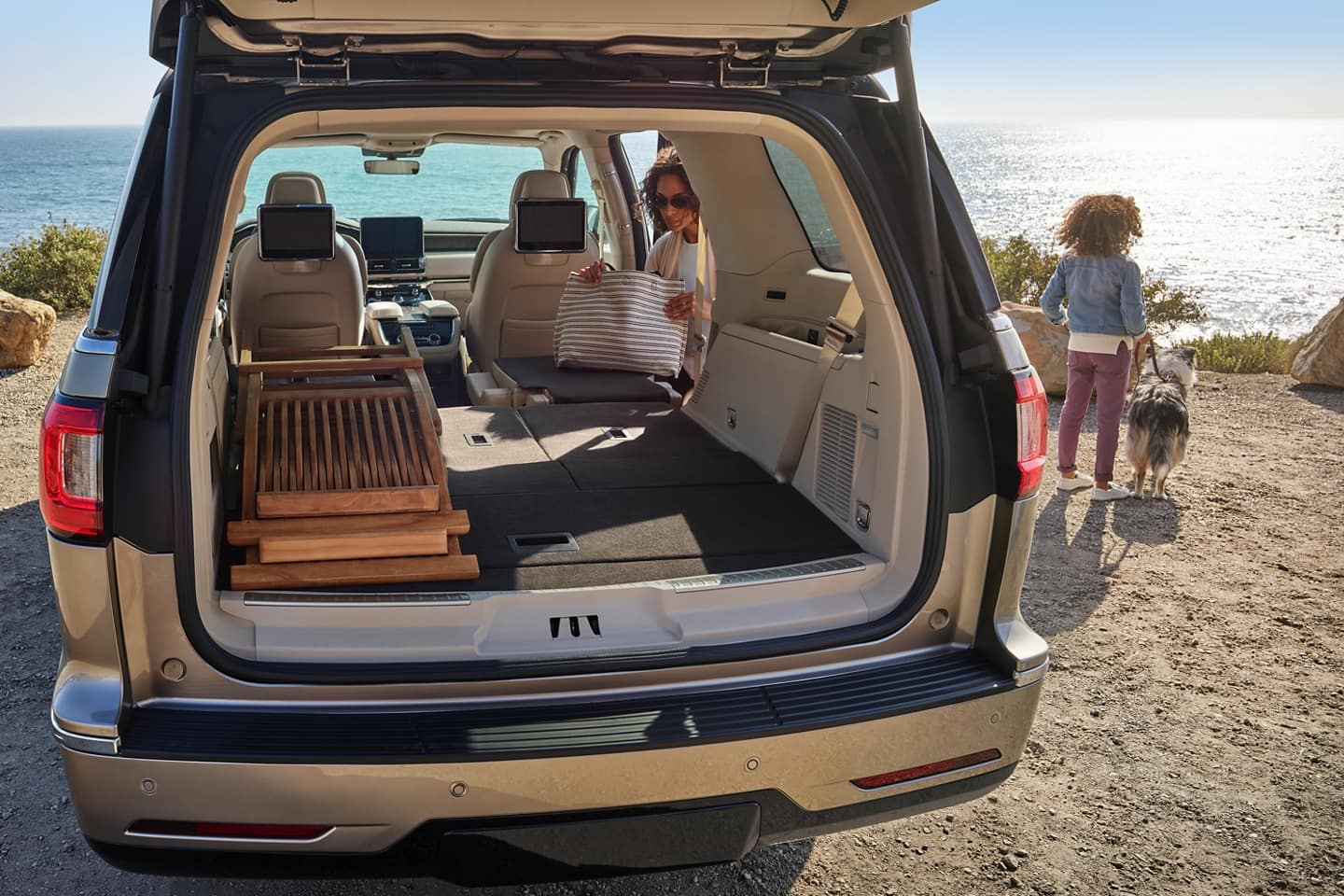 In the New Lincoln Navigator you can flatten the 2nd and 3rd row to maximize space.