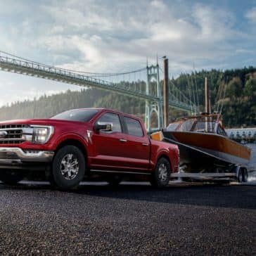 Tow your boat with a New 2021 Ford F-150 Truck. Order a Red 2021 F-150 at Team Sewell