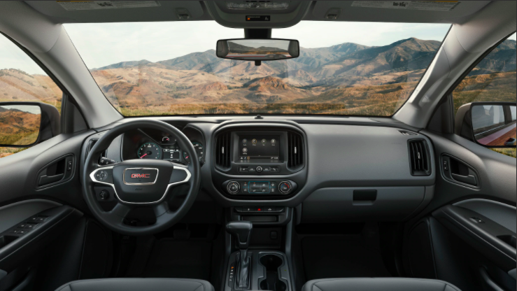 Dashboard view through the windshield of a 2021 Canyon truck