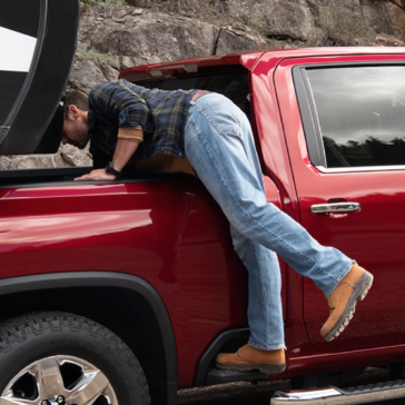 Step up to grab anything out of the large truck bed of the 2020 Chevy Silverado.
