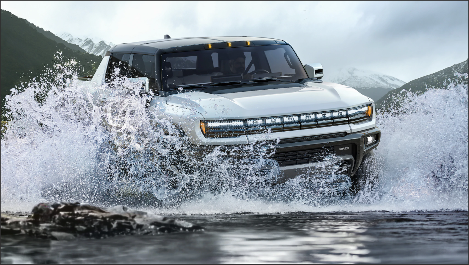 Picture showing the GMC Hummer drives through water